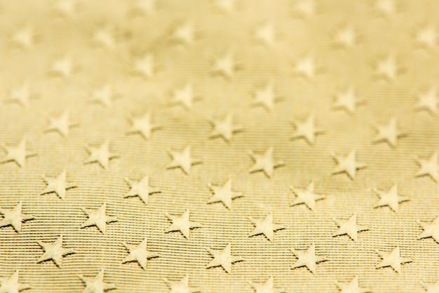 Étoiles d'or à motifs fond Photo gratuit