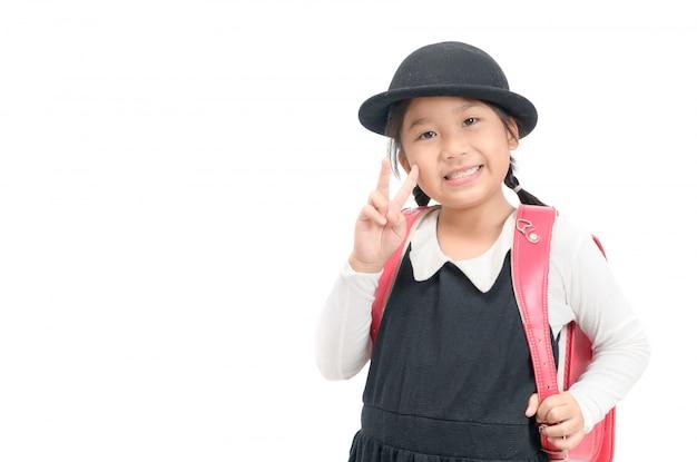 Étudiant japonais mignon avec cartable isolé Photo Premium