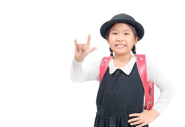 Étudiant japonais mignon montrent l'amour signe main isolé Photo Premium
