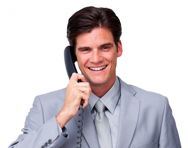 Exécutif masculin positif sur le téléphone Photo Premium