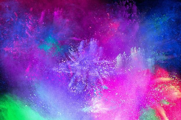 Explosion colorée pour la poudre happy holi. fond d'explosion de poudre de couleur. Photo Premium