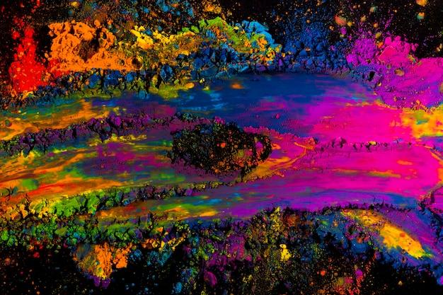 Explosion de poudre abstraite holi multicolore sur fond noir Photo gratuit