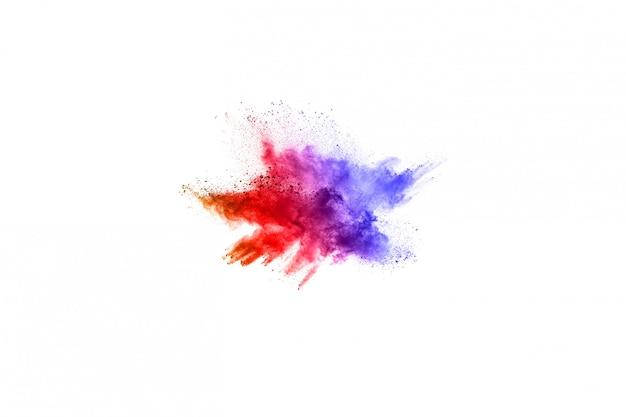Explosion de poudre colorée sur fond blanc. Photo Premium