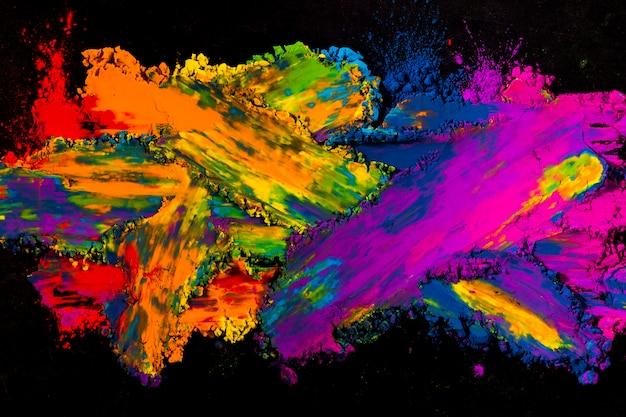 Explosion de poudre colorée sur fond noir Photo gratuit