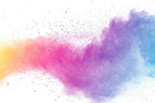 Explosion de poudre de couleur multi sur fond blanc. Photo Premium