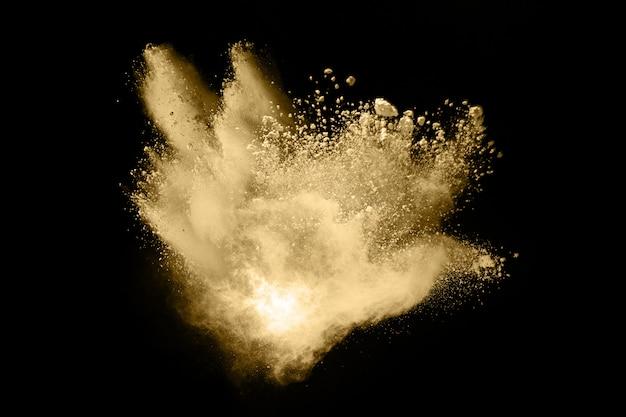 Explosion De Poudre Dorée Sur Fond Noir. Photo Premium