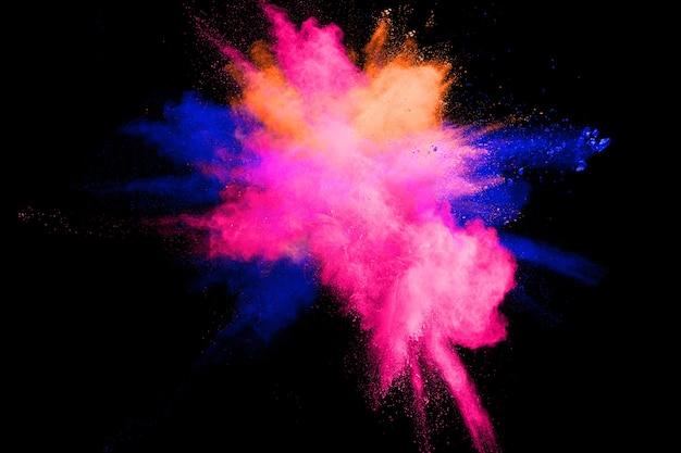 Explosion de poudre multicolore abstraite sur fond noir. Photo Premium
