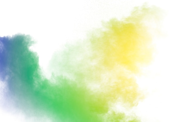 Explosion de poudre multicolore sur fond blanc. lancé de particules colorées sur fond. Photo Premium