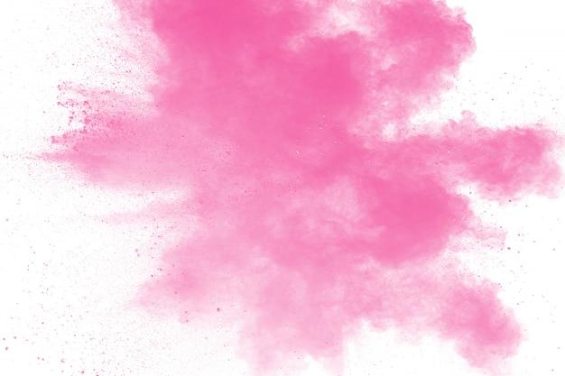 Explosion de poudre rose abstraite. figer le mouvement de la poussière rose éclaboussée. Photo Premium