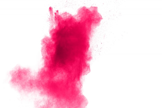 Explosion de poudre rose sur blanc. Photo Premium