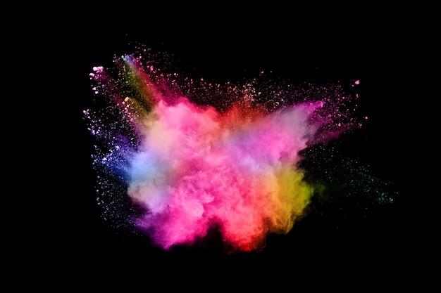 Explosion de poussière abstraite de couleur sur un fond noir. Photo Premium