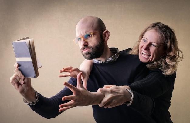 Faire valoir, couple, livre Photo Premium