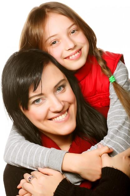 Famille heureuse sur blanc Photo Premium