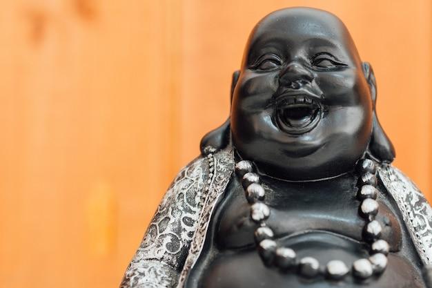 Fat bouddha qui rit, hotei dieu macro. Photo Premium