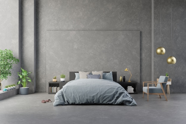 Fauteuil bleu foncé près du meuble et du lit avec draps dans le mur de béton intérieur de la chambre et les meubles modernes. Photo Premium