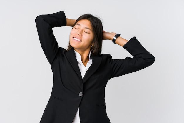 Femme D'affaires Asiatiques Jeunes étirement Des Bras, Position Détendue. Photo Premium