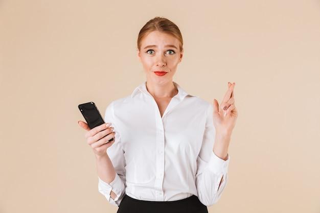 Femme D'affaires Inquiète Tenant Les Doigts Photo Premium