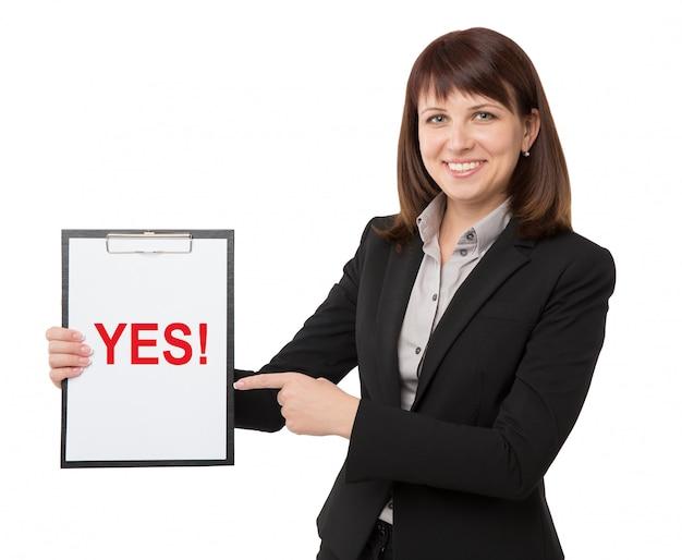 Femme d'affaires avec le presse-papier Photo Premium