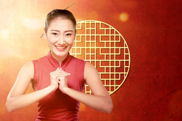 Femme Asiatique, Dans, A, Cheongsam, Robe, à, Félicitations, Geste Photo Premium