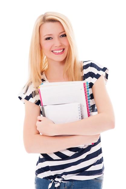Femme étudiante Tenant Des Cahiers Photo gratuit