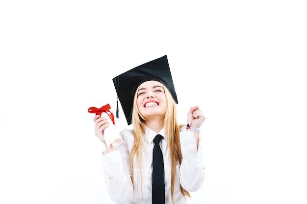 Femme heureuse excitée avec l'obtention du diplôme Photo gratuit