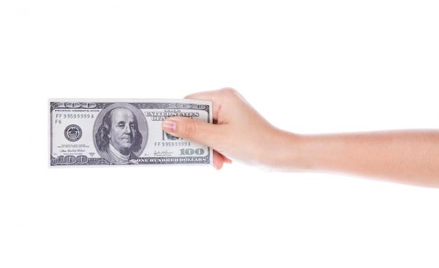 Femme main avec des dollars isolé sur fond blanc Photo gratuit