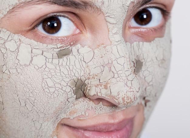 Femme, masque, regarder, appareil-photo, extrême, gros plan Photo gratuit