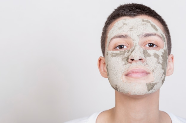 Femme, Masque, Regarder Appareil-photo Photo gratuit