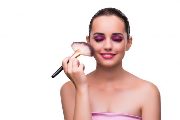 Femme se maquiller isolée Photo Premium