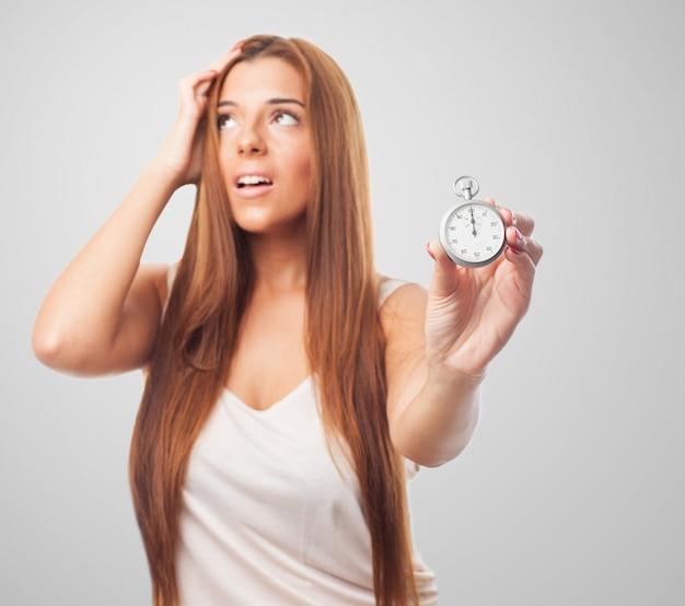 Femme Stressé Avec Chronomètre En Main Photo gratuit