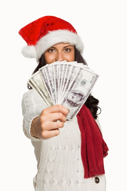 Femme tenant de l'argent Photo Premium