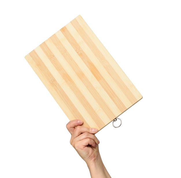 Femme Tenant Une Planche De Bois Rectangulaire Brun Vide Dans La Main, Partie Du Corps Sur Fond Blanc Photo Premium