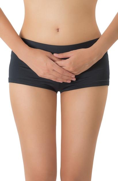 Femme tenant son ventre dans la zone de douleur isolée sur fond blanc Photo Premium