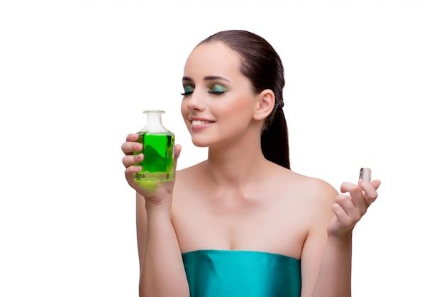 Femme, tenue, bouteille, parfum vert Photo Premium