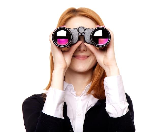 Femmes d'affaires recherchant des jumelles Photo Premium