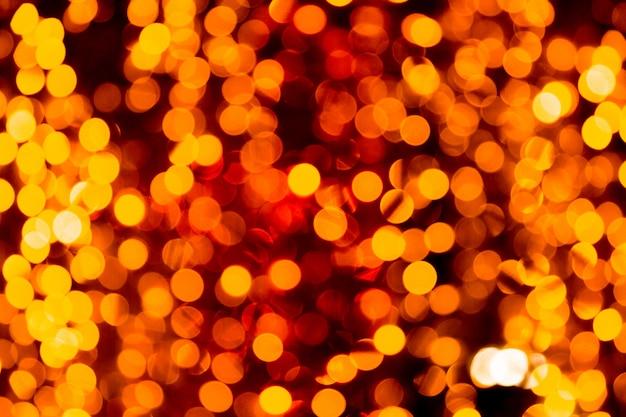 Festive or abstrait avec bokeh défocalisé et brouillé beaucoup de lumière jaune ronde Photo Premium