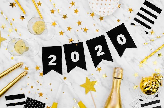 Fête du nouvel an 2020 guirlande et champagne Photo gratuit