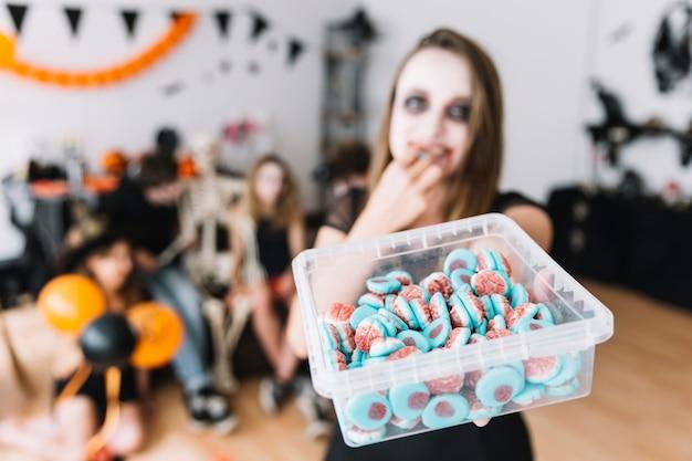 Fête d'halloween avec des bonbons Photo gratuit