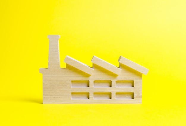 Figurine en bois d'une usine ou d'une usine Photo Premium