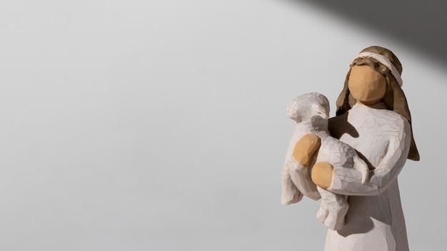 Figurine Féminine Du Jour De L'épiphanie Avec Mouton Et Espace Copie Photo gratuit