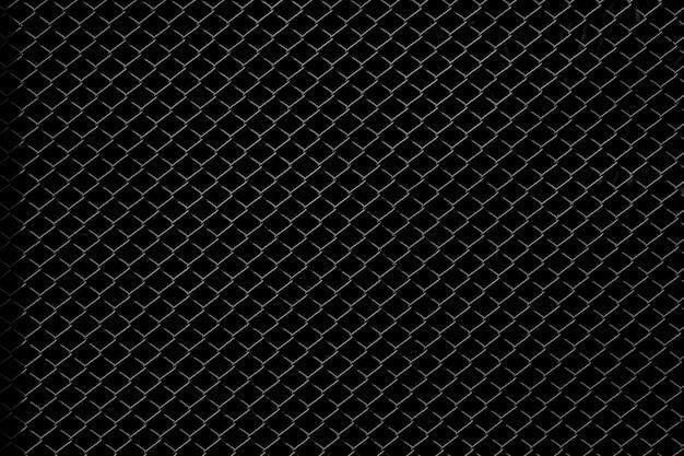 Filet métallique isolé sur fond noir Photo Premium