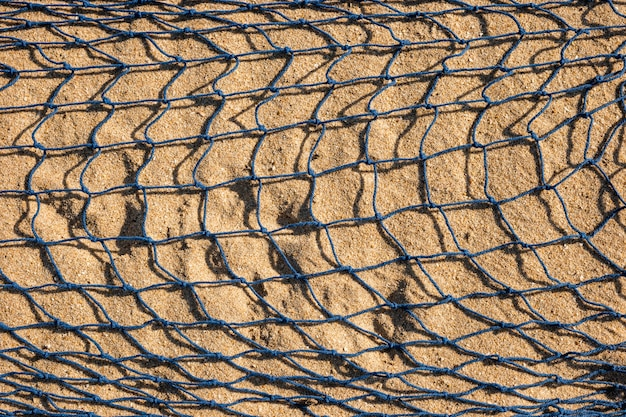 Filet de pêche sur le sable Photo gratuit