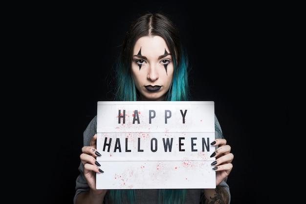 fille au maquillage d'halloween et enseigne | télécharger des photos