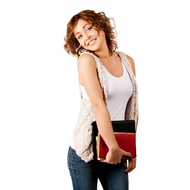 Fille heureuse jeune étudiant tenant des livres Photo Premium