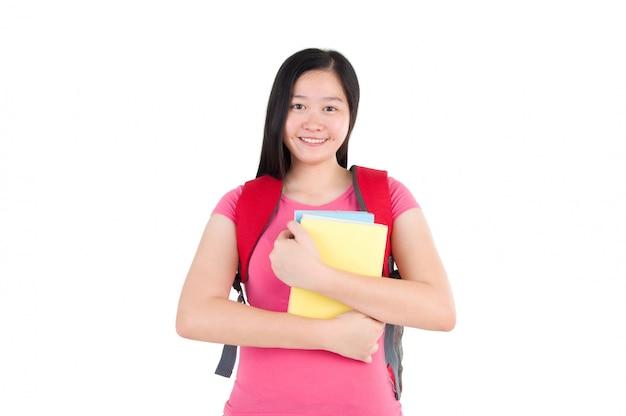 Fille jolie étudiante debout sur fond blanc Photo Premium