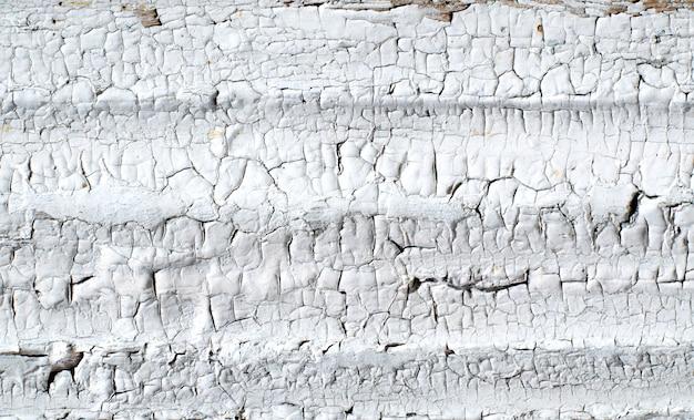 Des fissures sur un vieux mur peint Photo Premium