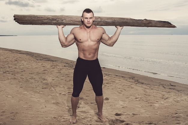 Fitness sur la plage Photo gratuit