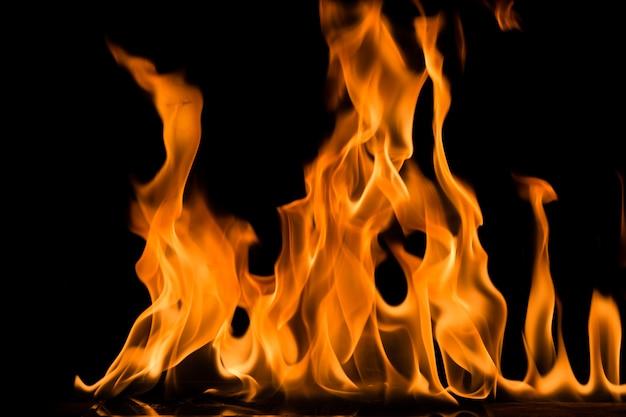 Flamme de feu sur fond noir. blaze feu flamme fond texturé. | Télécharger des Photos Premium