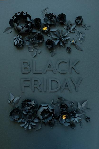 Fleurs en papier noir sur fond noir Photo Premium