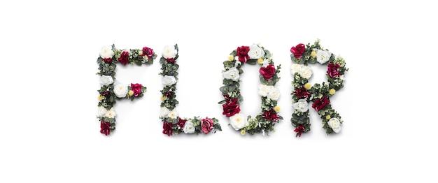 Flor mot fait de fleurs sur blanc Photo gratuit